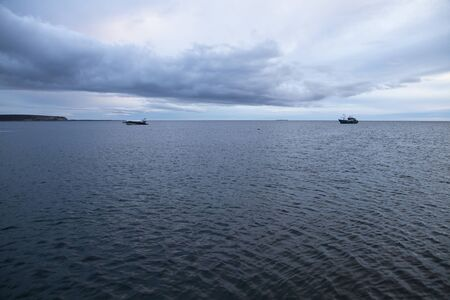 arenas: Two fishing boat at the strait of magellan near Punta Arenas, Chile Stock Photo