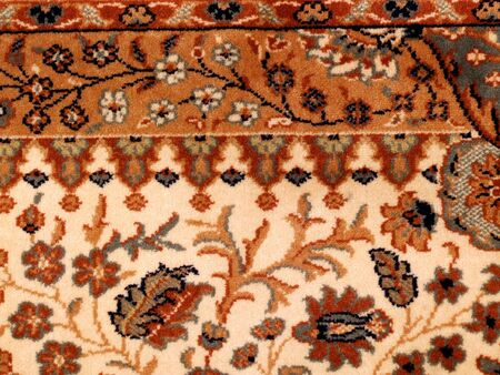 ornamented: Ornamented rug. Carpet background with floral patterns. Stock Photo