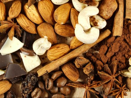 mixture: Mixture of nuts, coffee beans, cinnamon sticks and other spices and ingredients. Christmas cuisine.