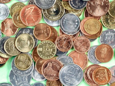 uncirculated: Coins of many currencies, mostly uncirculated. Different metals.