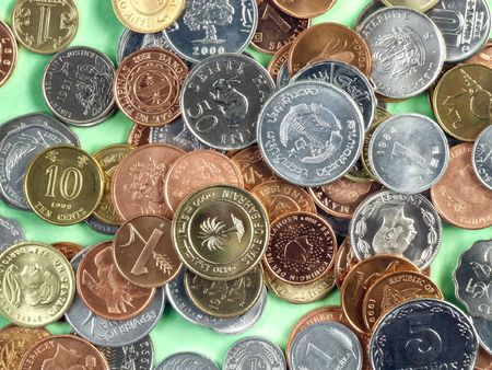 numismatic: World currencies from all continents - mostly uncirculated coins made of different metals. Global cooperation. Stock Photo
