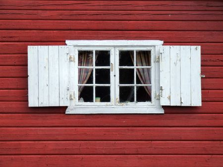 Old windows with white shutters. Typical Norwegian architecture.
