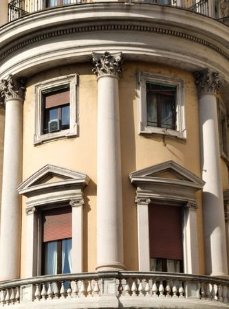 Beautiful building in Rome. Interesting ornamental windows and a balcony. Stock Photo - 689070