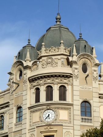 Old building with clock and triple dome. Barcelona architecture. Stock Photo - 689087