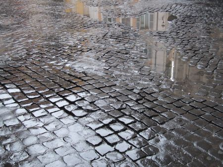 cobbled: Cobblestone - old street in Rome (Italy). A view just after rain.