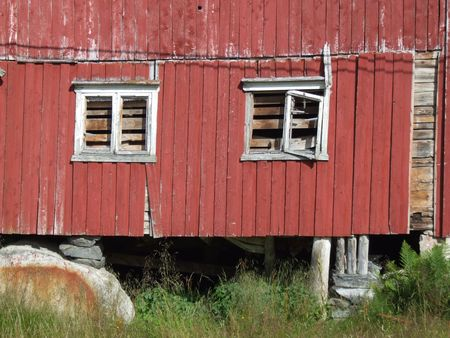 emptiness: Old building in ruin. Two dead windows, emptiness and abandonment.