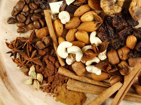 Mixture of nuts, coffee beans, cinnamon sticks and other spices and ingredients. Christmas cuisine.