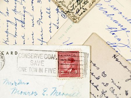 Old postcards with handwriting and a stamp from Canada.
