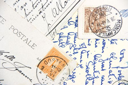Old postcards with handwriting and stamps from Belgium and Helvetia.