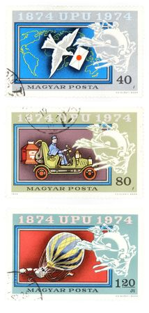 collectible: Collectible stamps from Hungary. Set with history of mail - pigeon, car and baloon. Stock Photo