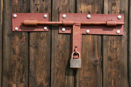 Vintage padlock and wooden door. Entrance to a barn. Stock Photo - 891247