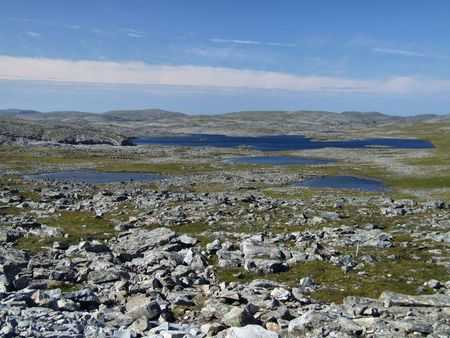 Lots of stones. Northern Norway landscape - plains with lakes. Stock Photo - 1052697