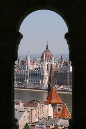 view through: Parliament view through the arch of Fishermens Bastion on castle hill, Budapest.