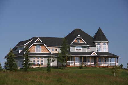 Big and expensive house in Victorian style. Canadian town. photo