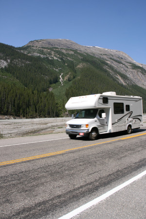 Recreational Vehicle in motion in Rocky Mountains of Canada (Icefields Parkway)