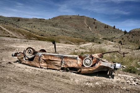 Crashed, rusty car in desert. Photo taken near Kamloops, British Columbia, Canada (North America). photo
