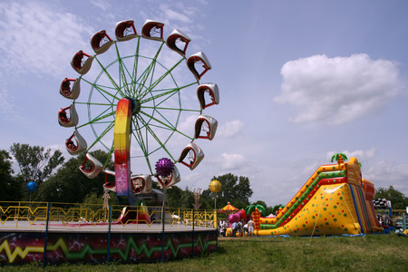 Colorful amusement park on a sunny summer day