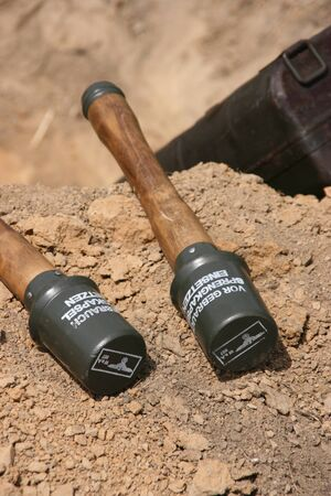 Original WW2 German stick grenades - focus is on the heads Stock Photo