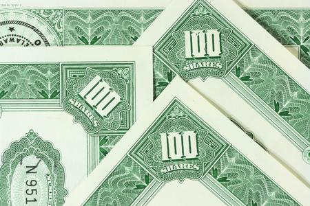 nyse: Close-up of a few 100 shares certificates. Vintage scripophily objects. Stock Photo