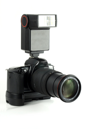 black grip: Professional camera with a battery grip, zoom lens, external flash and black body.