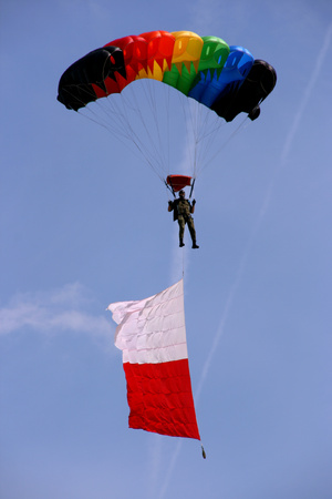 pilotage:  Airborne parachute jumper with flag of Poland. Stock Photo