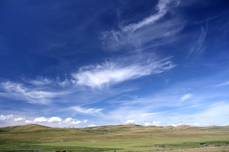 vista: Beautiful vista. Rural fields landscape with fantastic white clouds and blue sky. Stock Photo
