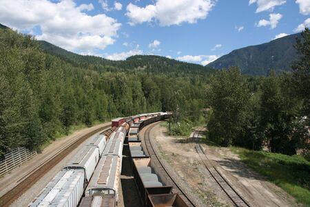 Cargo trains in Revelstoke, BC. Beautiful summer weather. photo