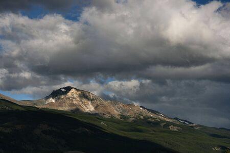 rock strata: Clouds over mountains - beautiful vista in Jasper National Park, Canada.