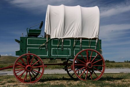 pioneer: Vintage horse-drawn cart. Western-type wagon.