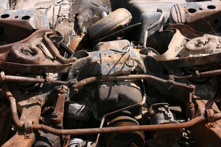 junked: Old destroyed car abstract. Rusty metal parts.