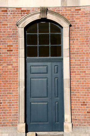 Wooden door and brick wall in Dublin, Ireland. photo