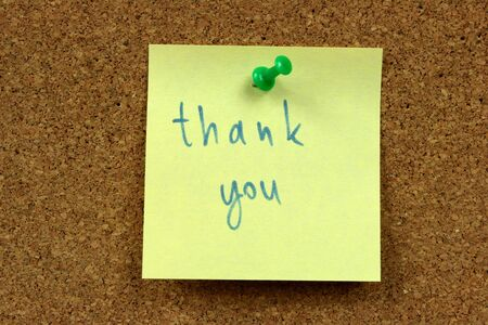 Yellow small sticky note on an office cork bulletin board. Gratitude concept. Stock Photo - 2404460