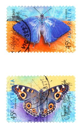 dull: Collectible stamps from Australia. Set with butterflies - dull oakblue (Arhopala centaurus) and meadow argus (Junonia villida) Stock Photo