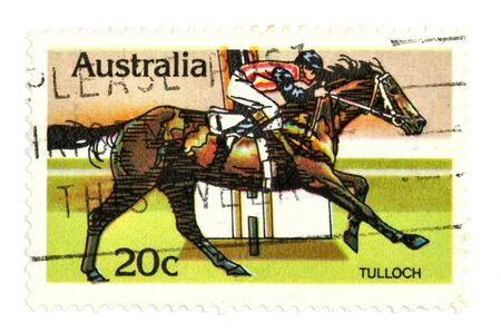 collectible: Collectible stamp from Australia depicting horse racing derby. Stock Photo