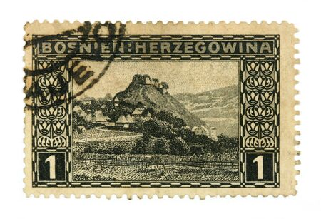 collectible: Collectible stamp from Bosnia and Hercegovina depicting a village in mountains.