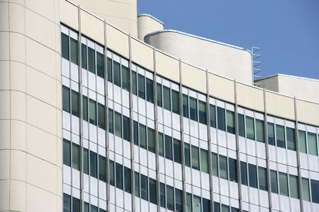 highriser: Fragment of UNO City building in Vienna. Modern skyscraper.