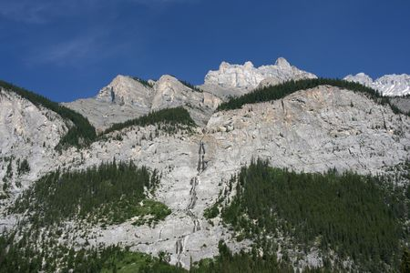 mountainside: Rocky Mountains in Banff National Park. Blue sky.