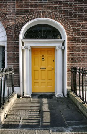 Georgian architecture of Dublin - yellow door in old building Stock Photo - 2536976