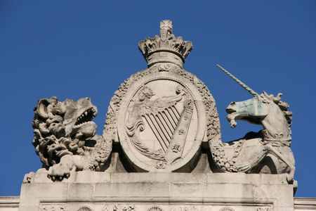 The Lion and The Unicorn - time-honoured symbols of the United Kingdom. The lion stands for England and the unicorn for Scotland. The statues are located on Customs House in Dublin, Ireland, so in the middle is national Irish Coat of Arms. Stock Photo - 2536972