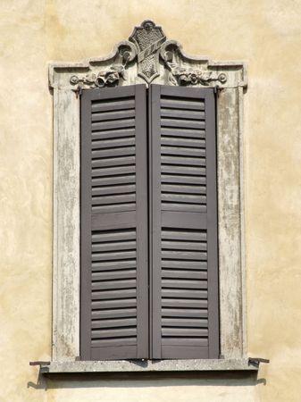 Window in Bergamo. Old architecture. Decorative ornaments. Stock Photo - 2625281