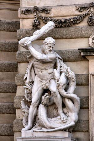Saint George killing the dragon - sculpture at Michaelerplatz in Vienna, Hofburg entrance photo