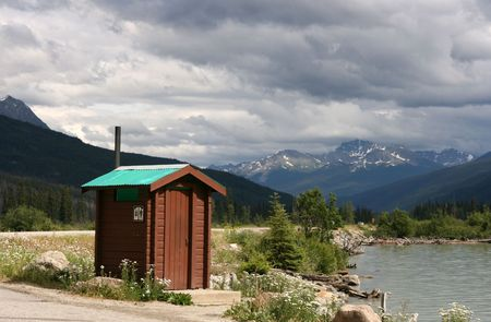 outhouse: Typical wooden outhouse restroom in Canada. Moose Lake, British Columbia.