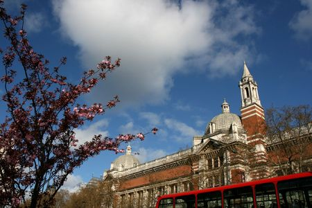 London, England - Victoria and Albert Museum, red double decker and blooming tree - springtime! photo