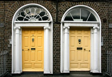Georgian architecture of Dublin - twin doors in yellow Stock Photo - 3001003