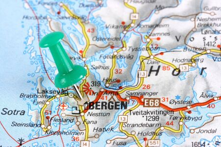 Bergen, Norway, Europe. Push pin on an old map showing travel destination. Selective focus. photo