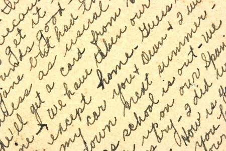 visible: Vintage hand writing on a letter. Old paper with visible structure. Pen ink.