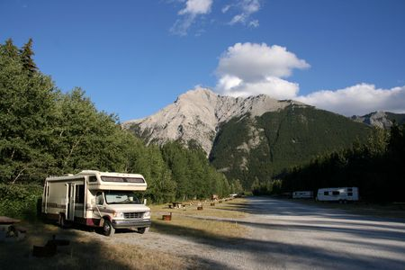 campground: Campground near Crowsnest Pass. Beautiful landscape of Canada. Parked RV .