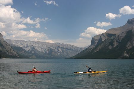 banff national park: Lake Minnewanka in Rocky Mountains of Canada. Banff National Park, Alberta. Kayaking.