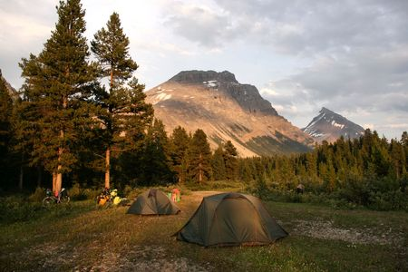 banff national park: Camping in Rocky Mountains of Canada. Banff National Park, Alberta. Tents in the sunset light.