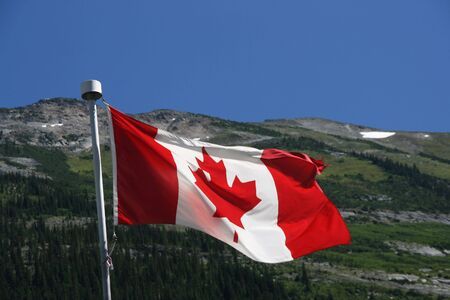 Flag of Canada against the background of Rocky Mountains photo
